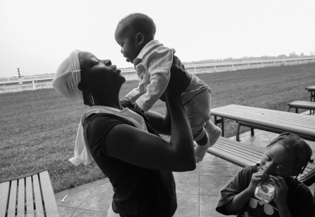 WEST PALM BEACH, FL - September 6, 2005: Michelle Johnson, 27, cradles her baby, I-Shelle, 7 months, at a evacuation shelter in West Palm Beach, FL on Sept, 6, 2005. The shelter is called Palm Meadows and is a training facility for thoroughbred horses. The Johnson family evacuated New Orleans after being stranded for days in their flooded home and having to watch dead bodies float by. (Photo by Todd Bigelow/Aurora)